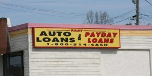 Sign advertising fast auto loans and payday loans