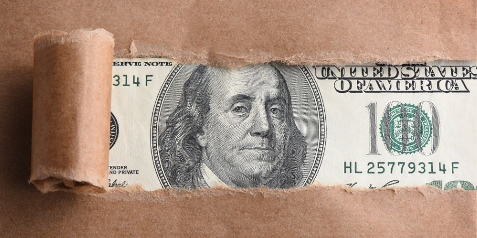 $100 Bill Revealed Behind Paper